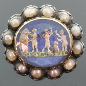 Late renaissance or Stuart Crystal slide brooch picturing Cupid s arrow smithy